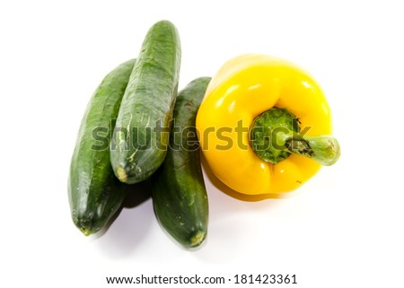 Fresh Yellow Capsicum with Green Cucumber - stock photo