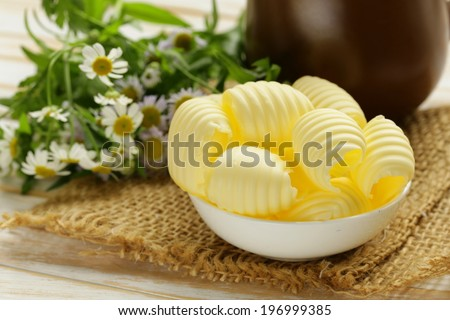 fresh yellow dairy butter in a white bowl - stock photo