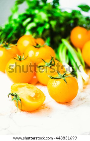fresh yellow tomatoes, juicy summer vegetables and juicy greens, healthy lifestyle and food concept - stock photo