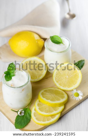 Fresh yogurt with lemon. Small depth of field  - stock photo