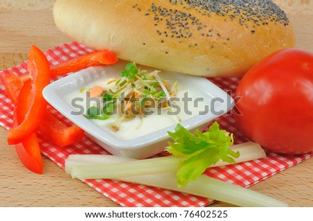 FRESH YOGURT with sprouts, vegetables and croissants on  BREAKFAST napkin  ON BOARD - stock photo