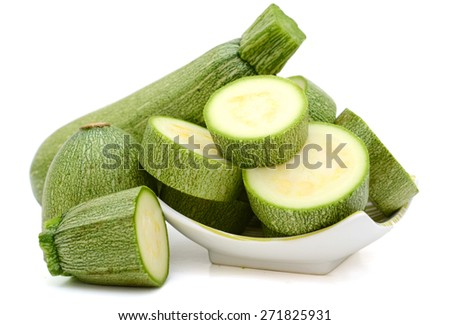 fresh zucchini on plate isolated on white  - stock photo