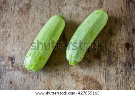 Fresh zucchini On wooden background. - stock photo