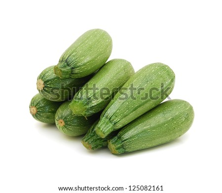 fresh zucchini's on a white background