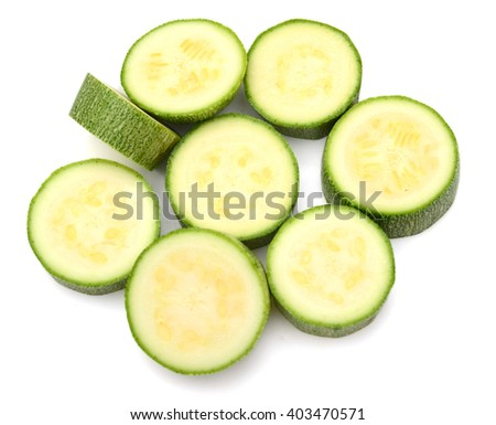 fresh zucchini sliced on white background  - stock photo