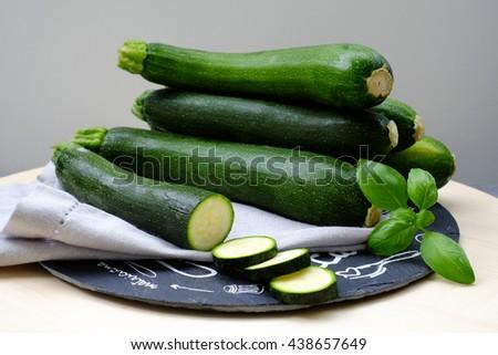 Fresh zucchini with basil.  - stock photo