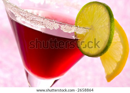 Freshening fruit cocktail with liquor decorated by segments of a lemon and lime - stock photo