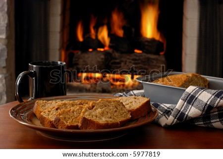 Freshly baked apple cinnamon bread served fireside - stock photo
