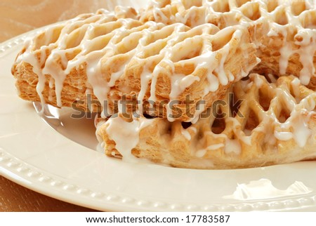 Freshly baked apple pastries.  Macro with shallow dof. - stock photo