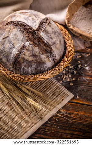 Freshly baked artisan bread in wicker basket - stock photo