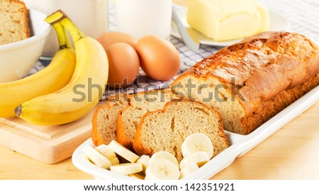 Freshly baked banana bread with various ingredients. - stock photo