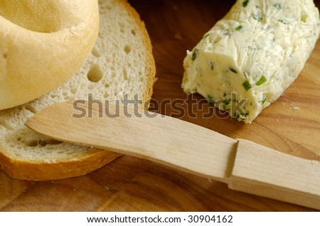 Freshly baked bread and a garlic butter - stock photo