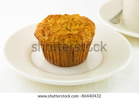 Freshly baked carrot and apple muffin on a plate./Baked Carrot Muffin - stock photo