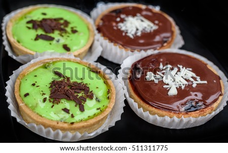 Freshly baked chocolate and lime tartlets.