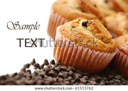 Freshly baked chocolate chip muffins on white background with copy space.  Macro with shallow dof. - stock photo