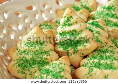 Freshly baked Christmas tree cookies in elegant serving tray.  Macro with shallow dof. - stock photo