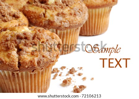 Freshly baked cinnamon muffins on white background with copy space.  Macro with shallow dof. - stock photo