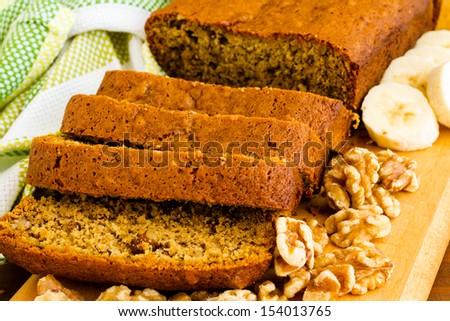 Freshly baked classic banana bread with walnuts and bananas. - stock photo
