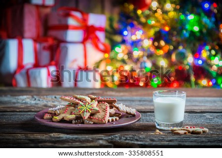 Freshly baked cookies with milk for Christmas - stock photo