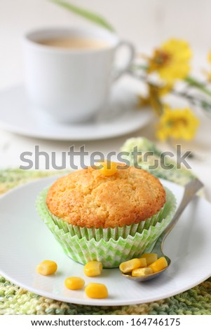 Freshly baked corn muffins on the plate - stock photo