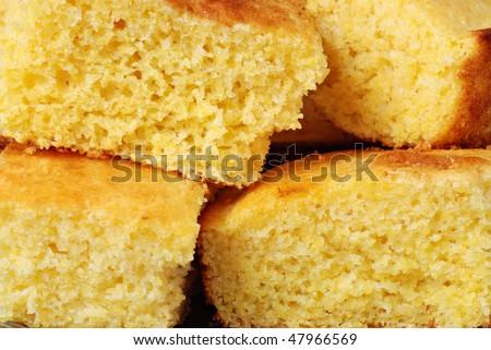 Freshly baked cornbread cut into squares. - stock photo