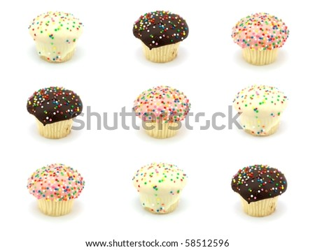Freshly baked cup cakes with hundreds and thousands - stock photo