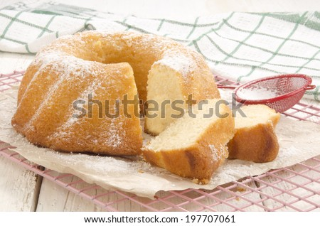 freshly baked curd cheese gugelhupf with powdered sugar  - stock photo