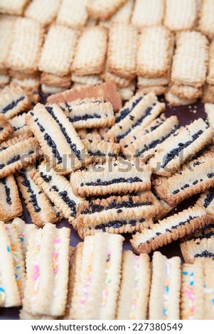 Freshly baked decorated condensed milk biscuits cooling off - stock photo
