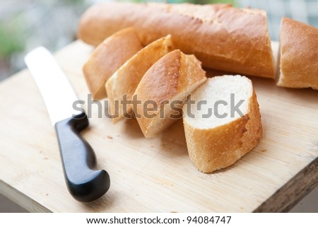 Freshly baked french baguette on wooden board