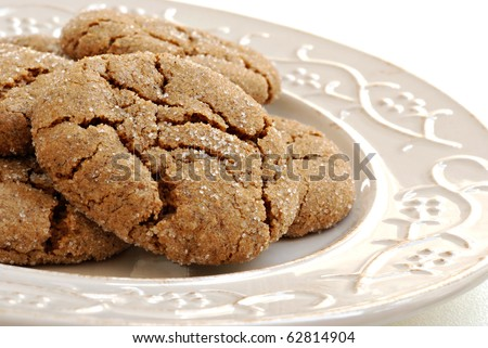 Freshly baked ginger cookies on decorative vintage plate.  Macro with shallow dof. - stock photo