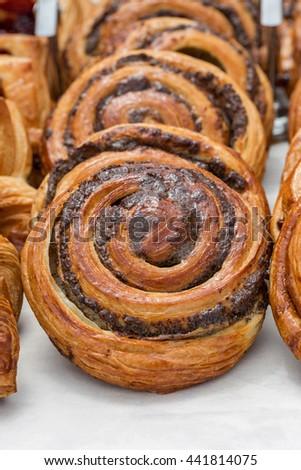 Freshly baked goods in organic bakery closeup - stock photo