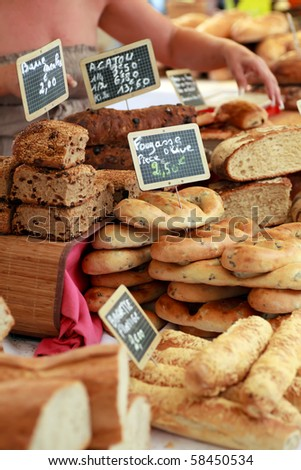 Freshly baked gourmet breads for sale in an outdoor French market - stock photo