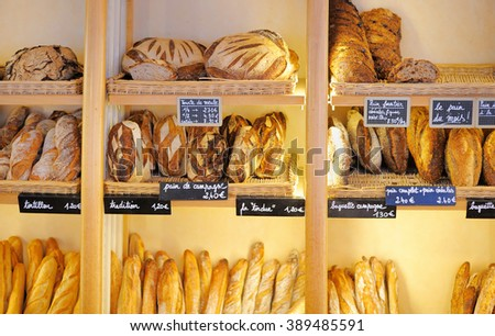 Freshly baked gourmet breads for sale in French bakery  - stock photo
