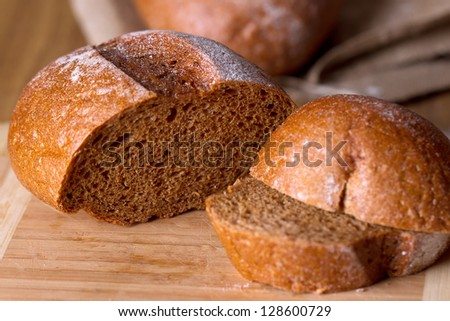 Freshly baked homemade bread dusted with flour - stock photo