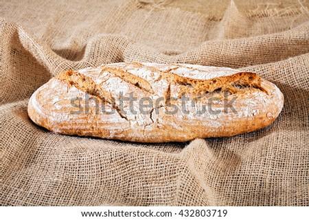 freshly baked homemade bread on a linen cloth - stock photo