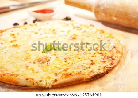 Freshly baked homemade pizza - stock photo