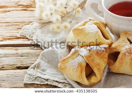 Freshly baked homemade scones and flower tea on the table. Homemade pastries . Close-up. Selective focus - stock photo