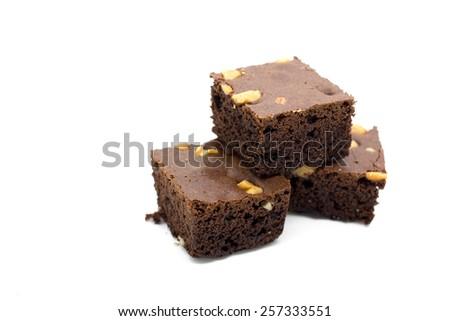 Freshly baked homemade walnut chocolate brownies on white. - stock photo