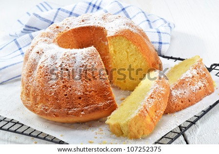 freshly baked lemon gugelhupf with icing sugar - stock photo