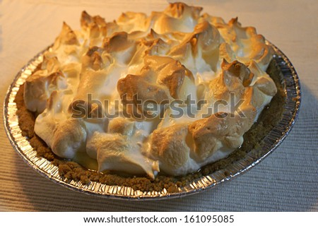 Freshly baked lemon meringue pie - stock photo
