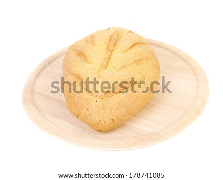 Freshly baked loaf of cornbread on platter. Isolated on a white background. - stock photo