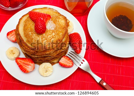 freshly baked pancakes with strawberry and banana - stock photo