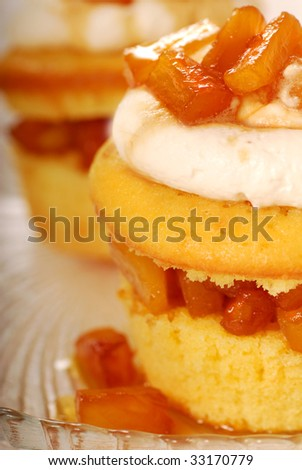 Freshly baked pineapple and amaretto cupcake with vanilla icing