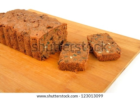 Freshly baked Plum Cake in a cake tray - stock photo