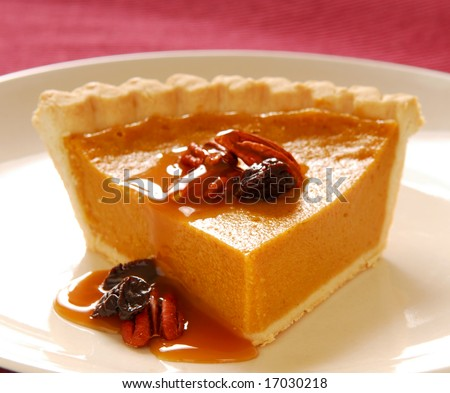 Freshly baked pumpkin pie with pecans, cranberries and a carmel sauce - stock photo