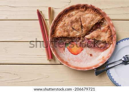 Freshly baked rhubarb pie, sliced and ready to serve - top view - stock photo