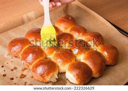 freshly baked rolls smeared garlic butter and dill - stock photo