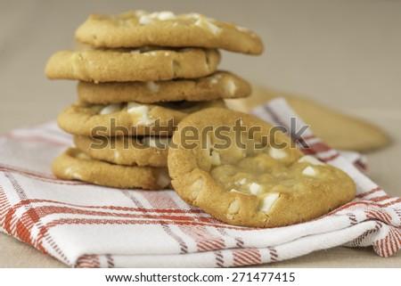 Freshly baked soft white chocolate and macadamia cookies. - stock photo