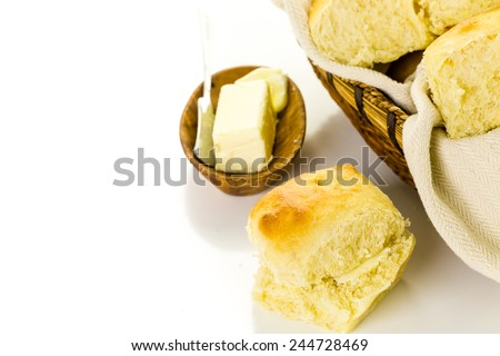 Freshly baked sourdough dinner rolls on a white background.