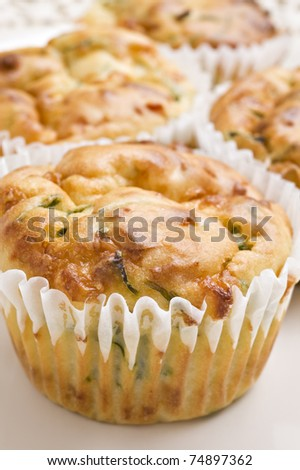 Freshly baked spinach and cheese muffins ready to be served - stock photo